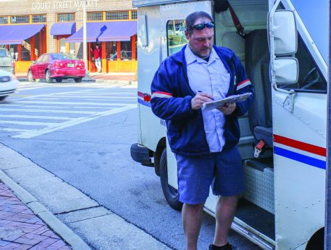 Jason Bates makes his rounds delivering mail to stores on Court Street. Many times our weekends, filled with fun, are spent forgetting the labor of others like Bates.