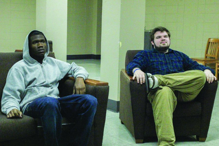 Rice Hall residents Emmanuel Nared (left) and Matthew Donovan watch TV in the residence hall mezzanine Feb. 18. Director of University Residences Kevin Jacques said only the bottom three floors of the hall will open next year but if more rooms are needed for upperclassmen, that number could increase.