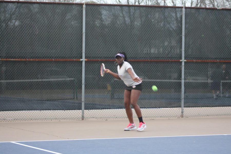 Sophomore+Olivera+Ngouabeu+gets+ready+to+hit+the+ball+during+a+practice+in+February.+Ngouabeu+was+named+All-GSC+as+a+freshman+and+is+the+No.+1+singles+player+for+the+Lions.