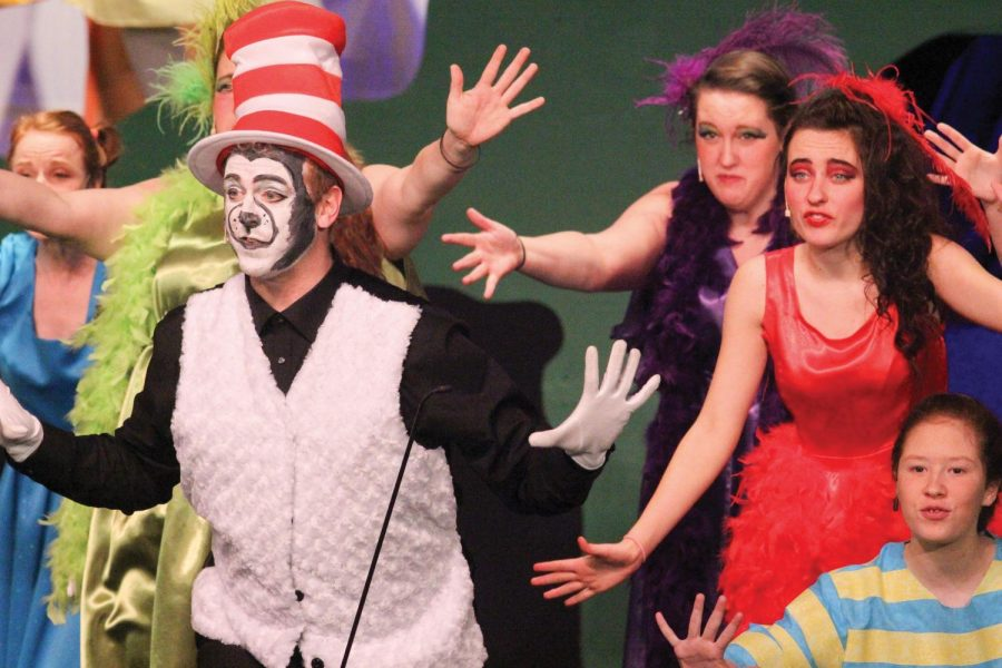 Will+Stanfield+%28cat+in+the+hat%29%2C+Logan+Hill+%28red%29%2C+Emily+Christmas+%28Purple%29%2C+and+Grace+Watkins+%28stripes%29+performing+during+the+dress+rehearsal+of+Seussical+musical.+The+Seussical+Musical+begins+showtime+Thursday+March+5th.