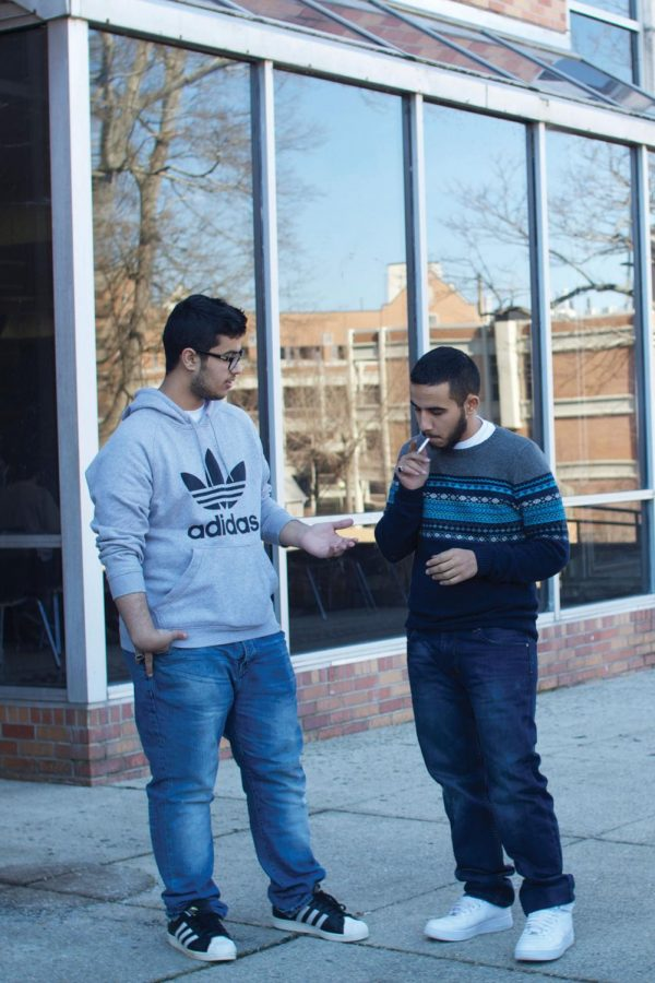 Two+UNA+students+take+a+smoke+break+together+outside+the+GUC.+SGA+members+said+they+will+likely+draft+legislation+urging+officials+to+implement+a+smoke-free+policy+at+UNA.