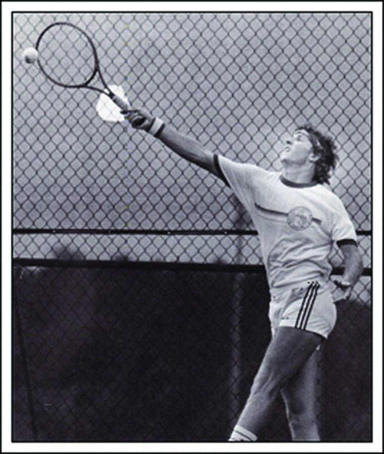 Head tennis coach Brice Bishop connects the ball back when he played for UNA in 1985. His wife, Carol, and his daughter, Mackenzie, played at UNA also while his son, Will, plays on the baseball team.