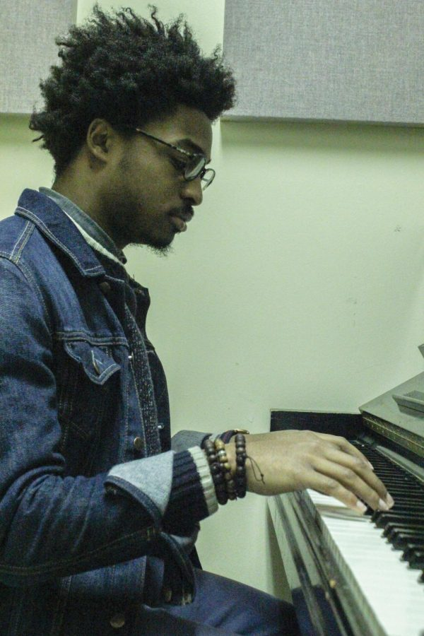 Philip+Towns%2C+former+student+of+UNA%2C+playing+piano+in+one+of+the+practice+rooms+on+campus.+He+has+made+songs+with+The+Voice+season+7+contestent+and+UNA+student+Jordy+Searcy.