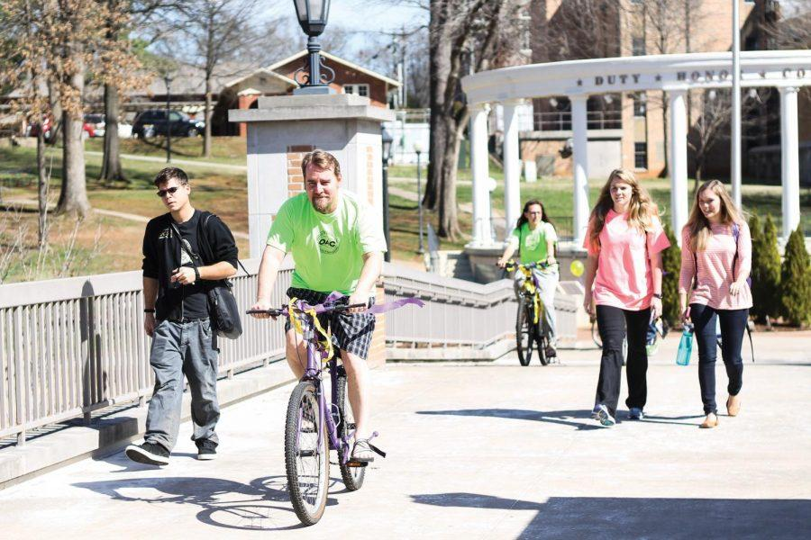 Patrick+Shremshock+rides+a+bike+across+campus+March+16+to+celebrate+the+Share+the+Road+campaign.