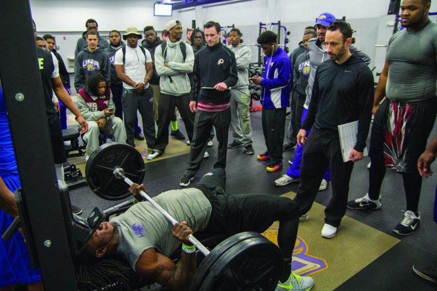 Former+Lions+linebacker+Brion+James+bench+presses+225+pounds+as+NFL+scouts+and+UNA+players+watch.+James+is+one+of+eight+UNA+players+to+perform+NFL+combine+drills+for+the+UNA+Pro+Day+March+9.