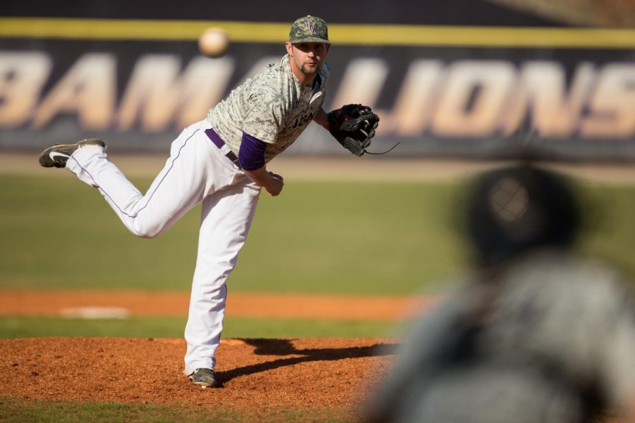 Junior pitcher Austin Carpenter throws a pitch against Miles College March 12. Carpenter is one of three relievers with an ERA under 1.94 and at least eight appearances for the Lions.