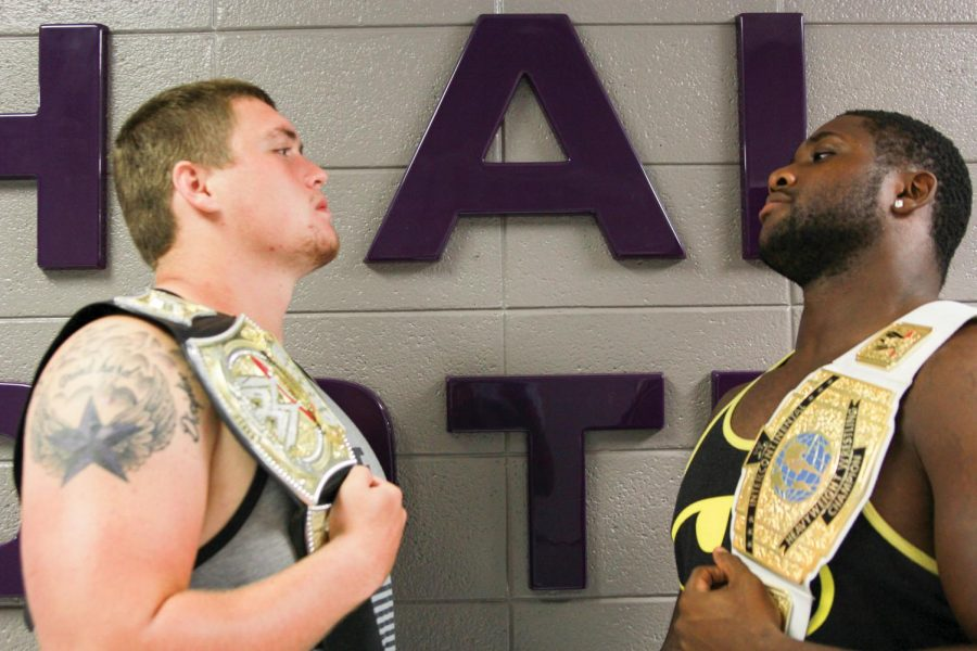 Juniors Brian Puckett (left) and Sheldon Lewis stare each other down with titles over each one's shoulder. Both are UNA football players desiring a career in wrestling after football is over.