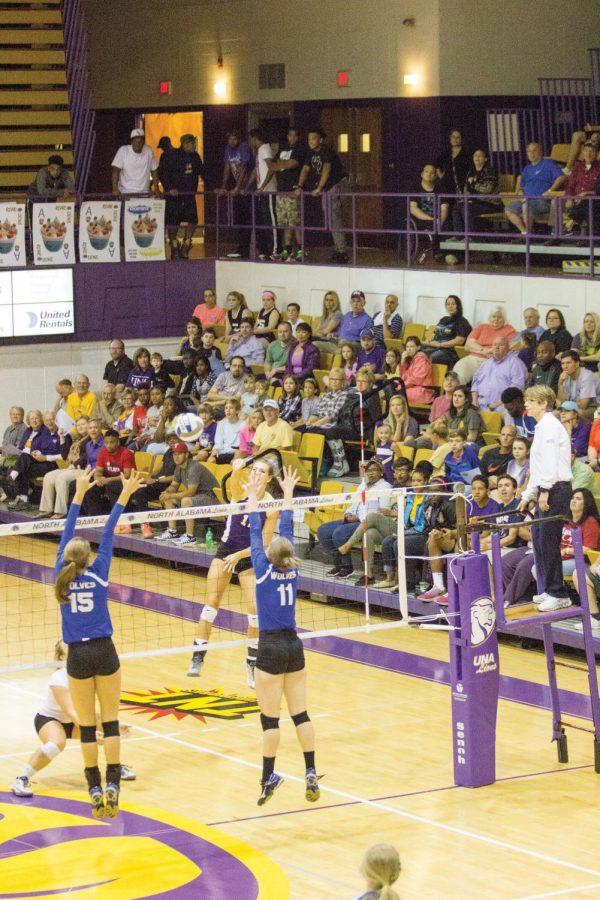 Sophomore+outside+hitter+Lexie+Bradley+%28Purple+12%29+attempts+the+kill+for+the+Lions.+UNA+defeated+West+Georgia+in+three+straight+sets+and+broke+the+school+record+for+volleyball+attendance+Sept.+29.
