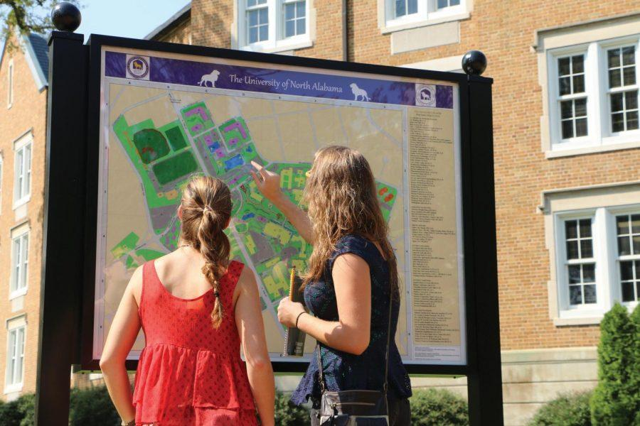 Savannah+Herbst+and+Lynn+Hartman+use+the+campus+map+next+to+Keller+Hall.+There+is+another+map+located+next+to+the+Stone+Lodge.