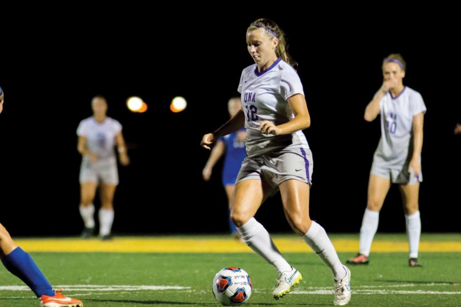 Junior Midfielder Eleanor Costello takes control of the ball as she drives down the field. Costello and the women's soccer team had a magnificent second half to come back and beat UAH 6-1 Sept 17.