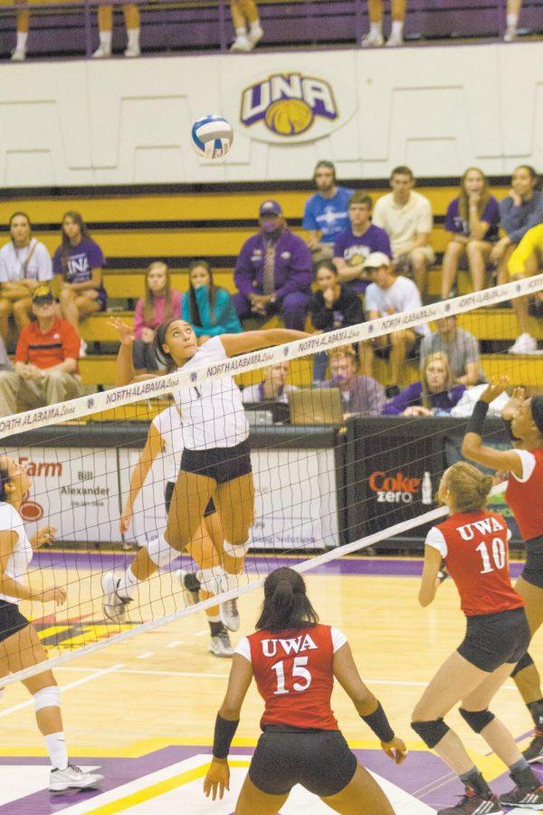 Sophomore+Jessica+Austin+spikes+the+ball+for+the+UNA+Lions.+The+Volleyball+team+defeated+in-state+conference+rival+West+Alabama+3-0.