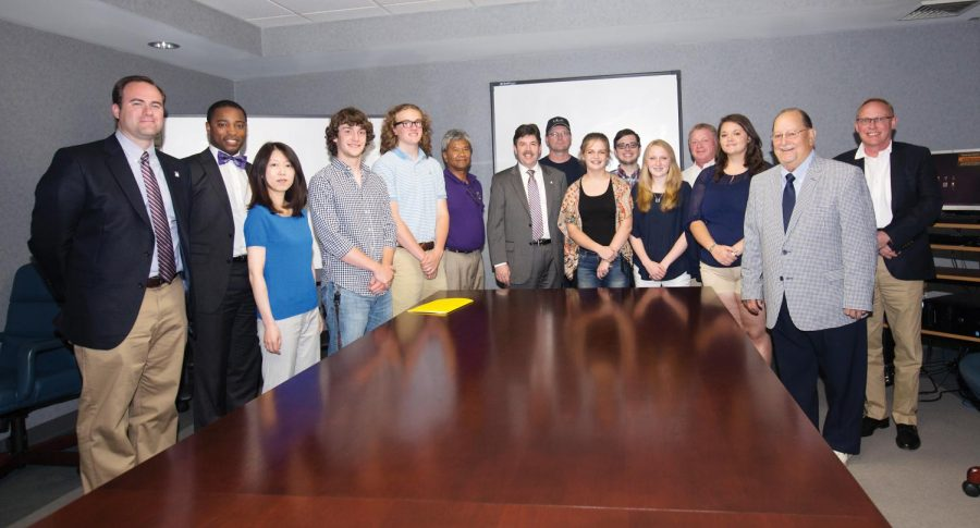 Russellville rocketry team students pose with university officials in May after winning gold at the Team America Rocketry Challenge National finals. The team will participate in UNA's launch competition in March.