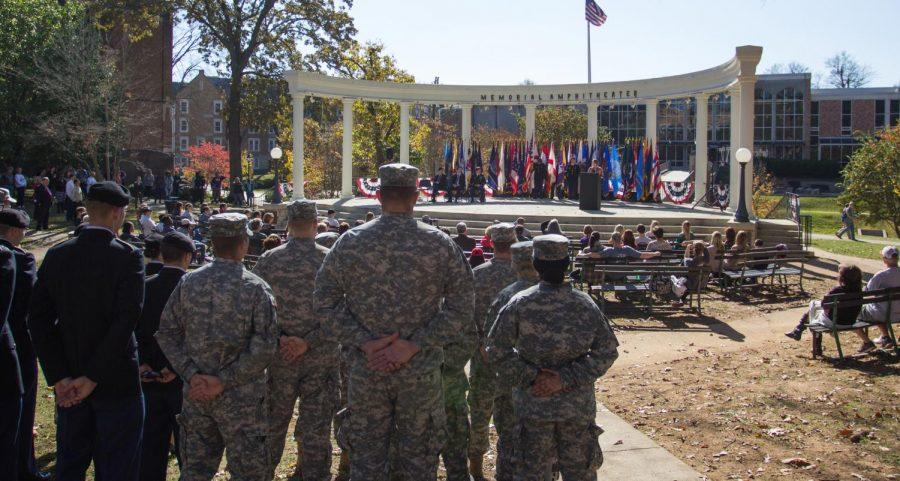 Veterans and active duty soldiers stand at attention as Katherine Canlas Richey, UNA alumna and retired U.S. Army staff sergeant, speaks at the annual Veteran's Day Commemoration Ceremony Nov. 11. Instructor Wayne Bergeron said around 300 students attending UNA currently serve or have served in the military.