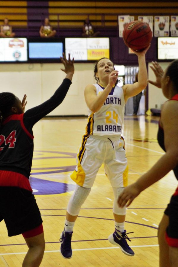 Sophomore guard Jaclyn Heath drives the lane against West Alabama Dec. 13. The Lions earned its first conference win of the season, as Heath tied a single-game school record with seven three-pointers.