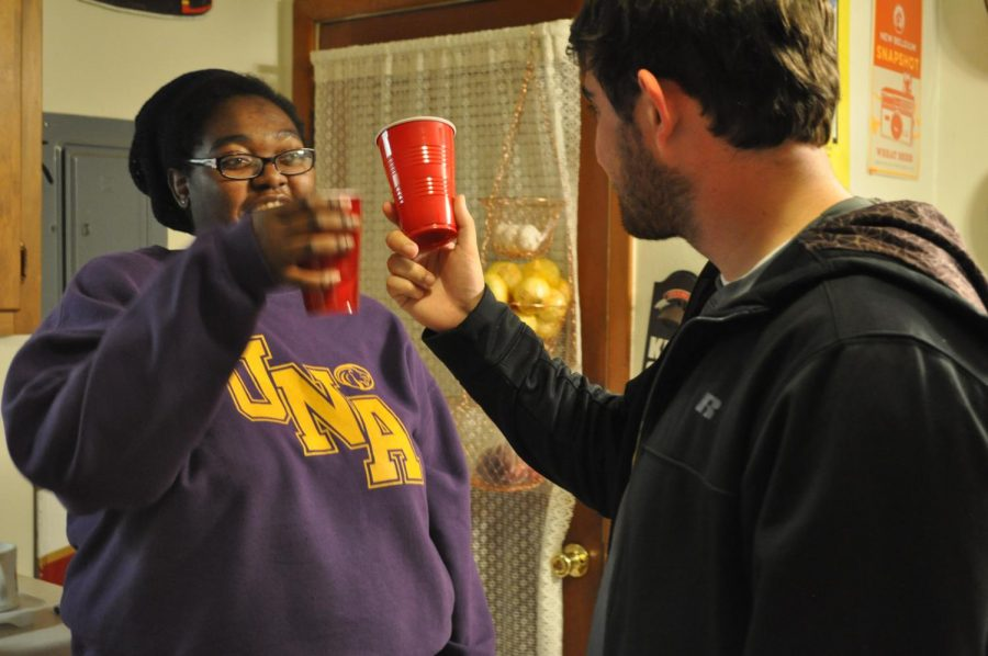 Managing Editor Jasmine Fleming and Associate Sports Editor Kadin Pounders make a toast. Fleming and Pounders, along with Editor-in-Chief Kali Daniel, tasted holiday drinks in the name of journalism.