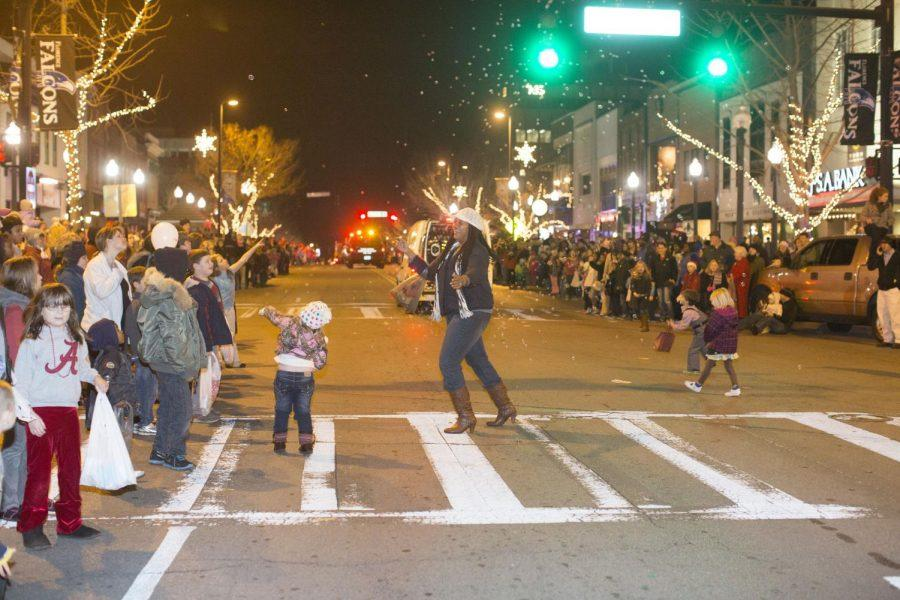 Parade spectators collect candy at the 2014 Florence Christmas Parade. Florence Main Street Director Teryl Shields said she expects 3,500 to 5,000 people to attend the event this year.