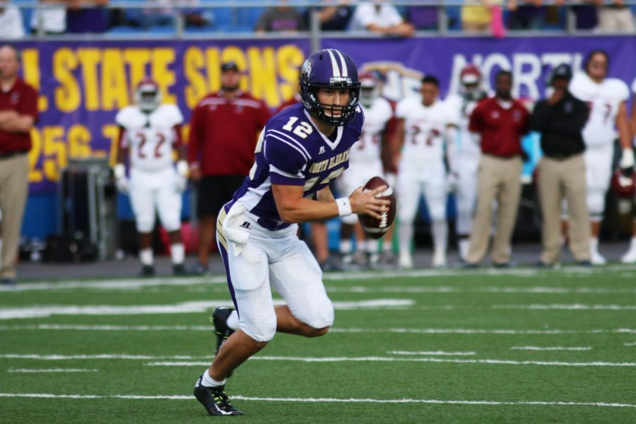 UNA+quarterback+Luke+Wingo+scrambles+out+of+the+pocket+against+Florida+Tech+Sept.+26.+Wingo+and+seven+other+players+are+national+finalists+for+the+Harlon+Hill+trophy%2C+presented+to+the+nation%27s+best+player+in+Division+II.