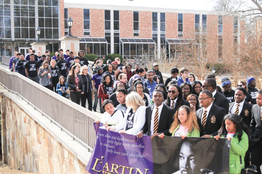 Students+and+volunteers+march+in+the+Martin+Luther+King+Jr.+memorial+march+in+January+2015.+Student+engagement+will+host+a+service+day+and+memorial+march+Jan.+18.