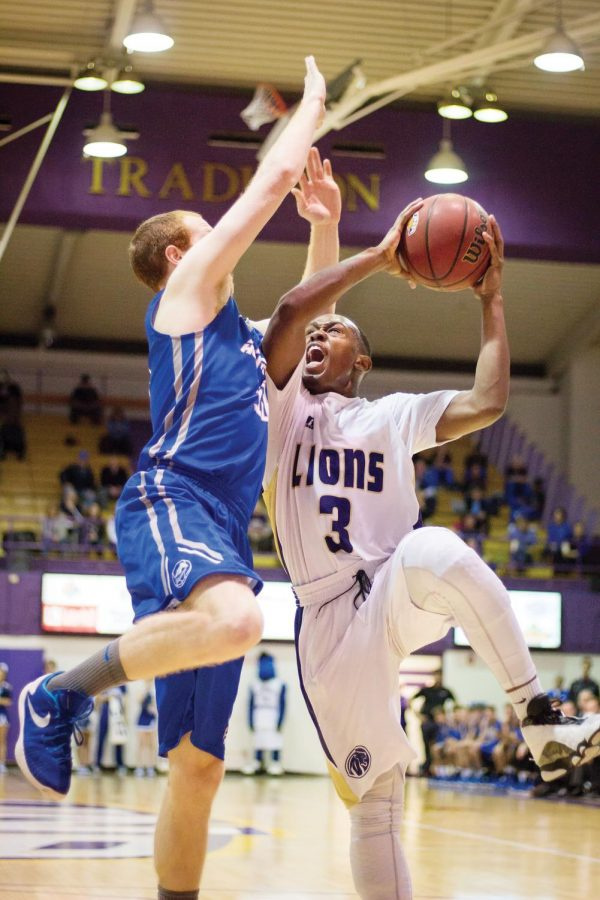 Junior guard Jeff Hodge (right) draws contact during UNA's 119-103 win against Alabama-Huntsville Jan. 16 in Flowers Hall. Over 1,000 fans were in attendance to watch the rivalry take place.
