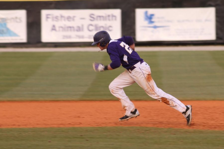 Freshman+outfielder+Conner+Kiser+advances+on+the+base+paths+during+UNA%E2%80%99s+12-1+win+against+Stillman+College+Feb.+7.+The+Lions+outscored+their+opponents+43-6+through+the+first+four+games.