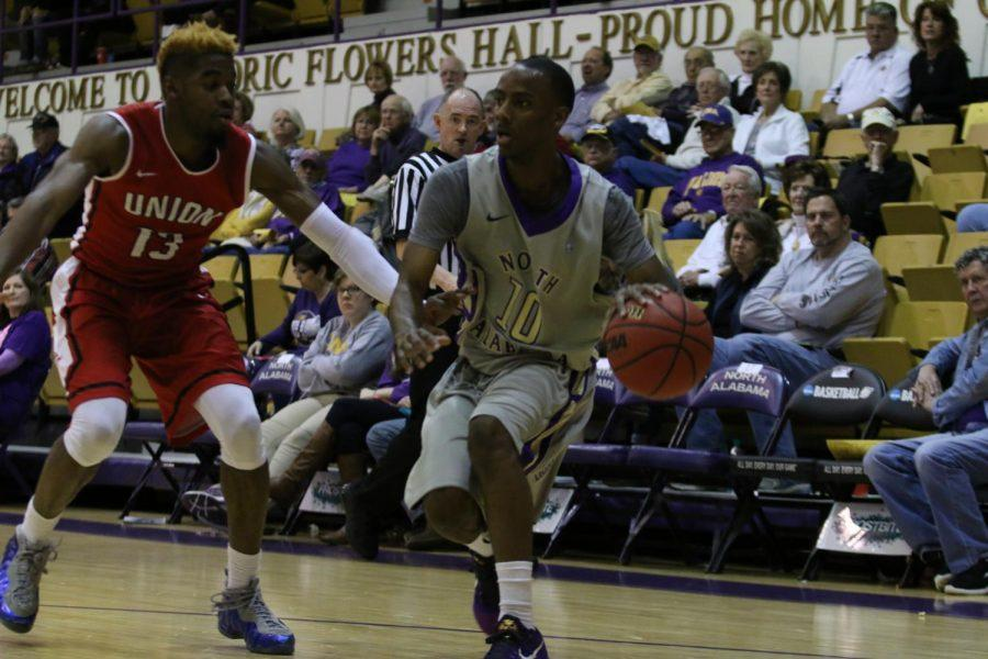 Senior John Fletcher dribbles back against a Union defender during an 87-73 loss to the Bulldogs Feb. 18. The Lions are in a four-way tie for third place in the conference standings.