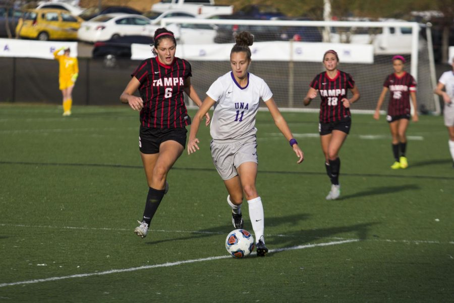 Former UNA forward Chloe Richards dribbles ahead against Tampa in the NCAA Division II playoffs last fall. Richards signed a professional contract with the SC Sand of the German Bundesliga in February.