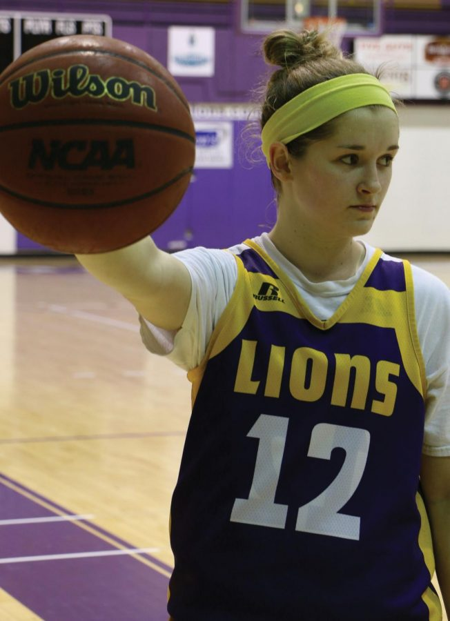 Redshirt freshman guard Savannah Stults looks on as teammates shoot around after practice Jan. 26. Stults played at Lexington High School, a county school near the UNA campus, and she draws a crowd of supporters from the area.