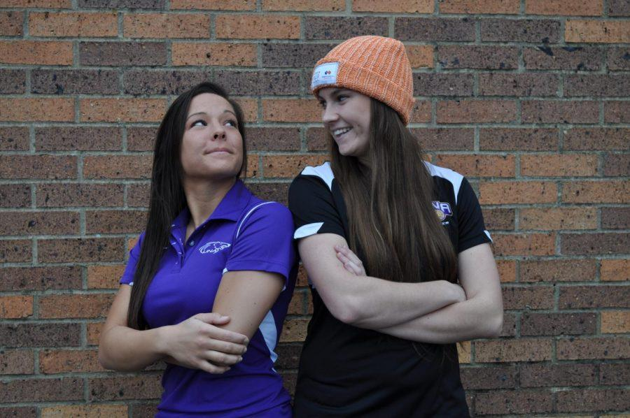 Junior soccer player Alyssa Bova (left) admires teammate Ele Costello's Love Your Melon hat. Both players took the initiative to start a UNA branch of Love Your Melon, an apparel brand whose mission is to give a hat to every child battling cancer.