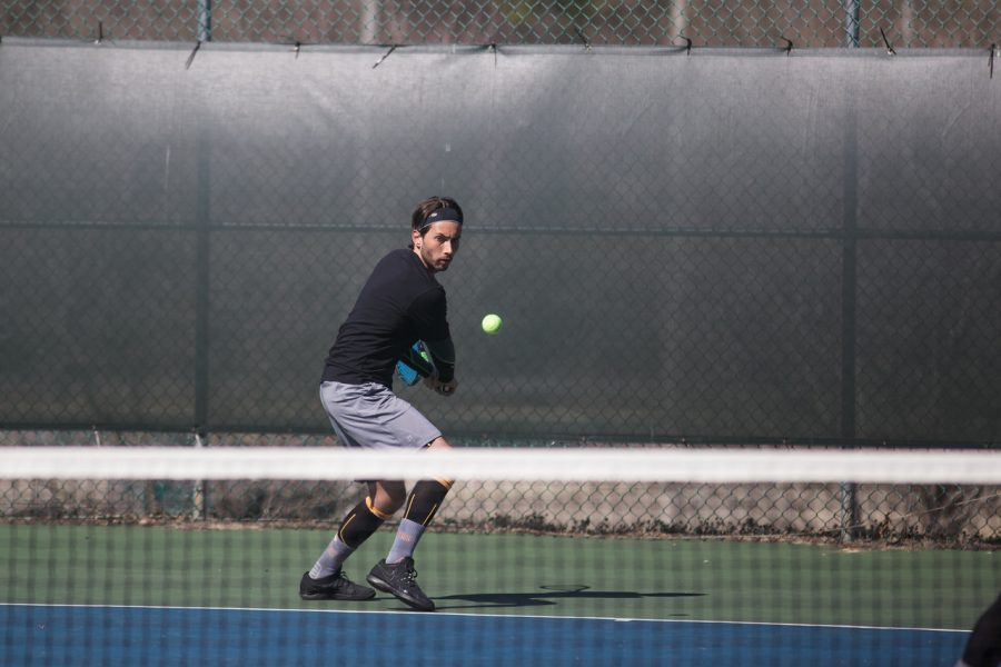 Tennis+player+Benji+Poire+prepares+to+backhand+a+shot+in+UNA%E2%80%99s+match+against+Delta+State+Feb.+28.+Poire%2C+a+graduate+student+from+Amiens%2C+France%2C+is+7-2+from+the+four+seed+this+season.