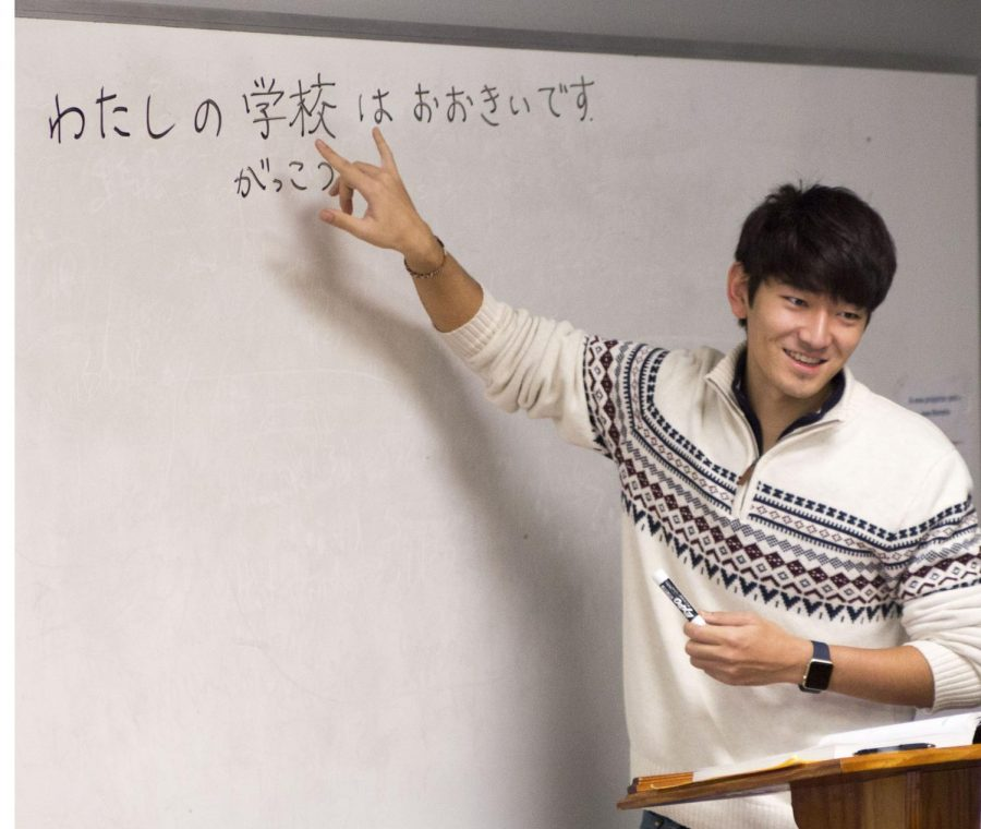 "Sophomore Yutaro Funaki teaches his Elementary Japanese class. ""Because he grew up (in Japan), he knows the nuances of the language better than a textbook can sometimes convey,"" said junior Trevor Kurzhal."