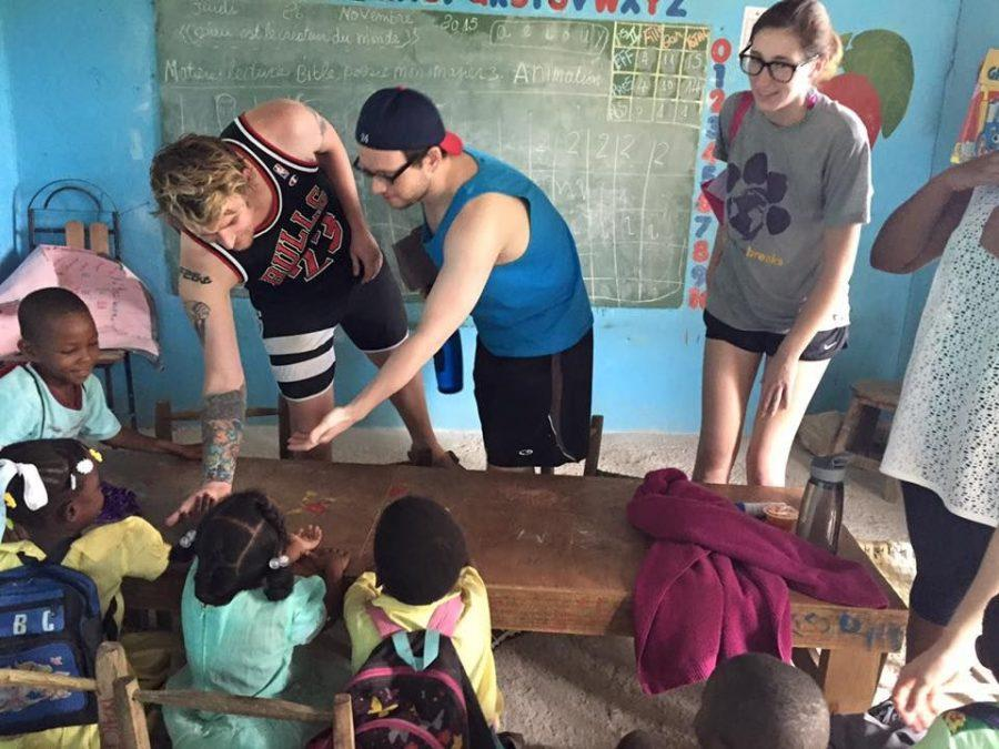 Students interact with children during the Alternative Breaks trip to Haiti in November 2015. The group will return to Haiti during spring break.