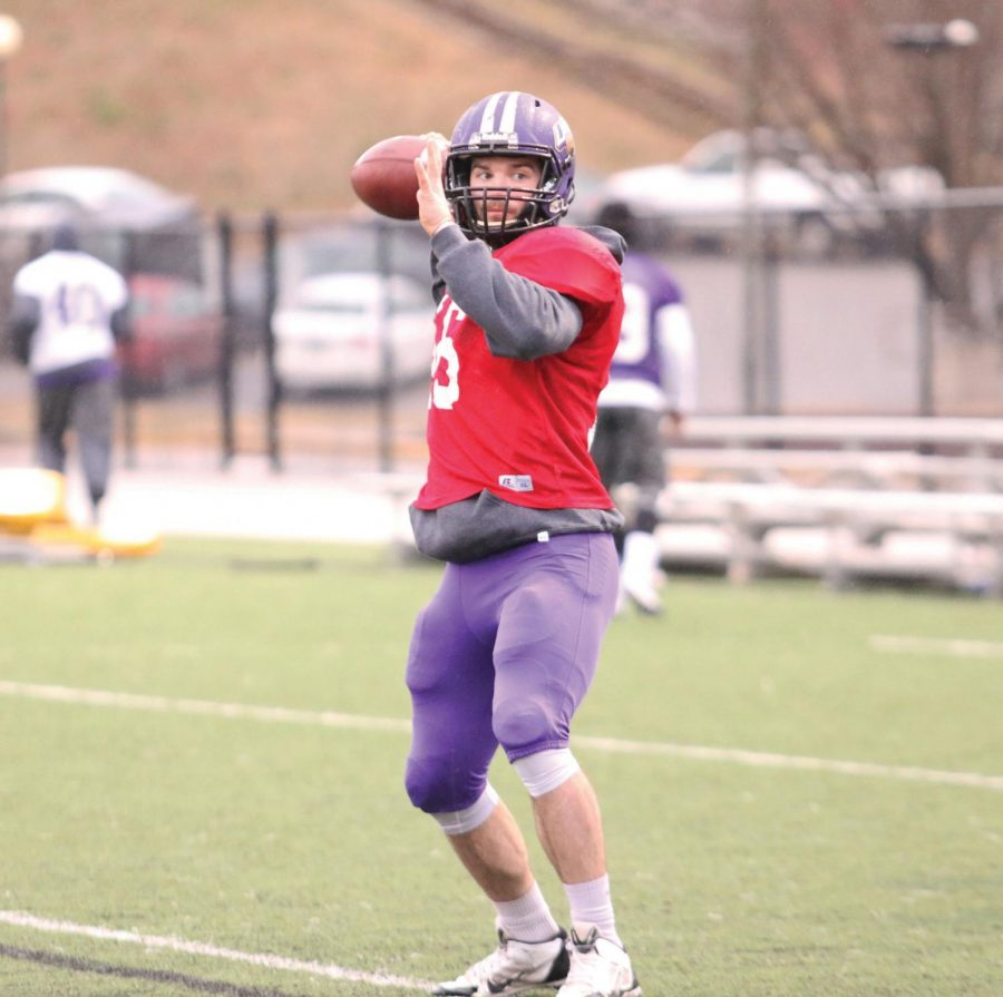 Senior quarterback Jacob Tucker drops back to throw a pass during a UNA football spring practice Feb. 24. Tucker played as a backup quarterback the last three years, and many people expect him to start next season.