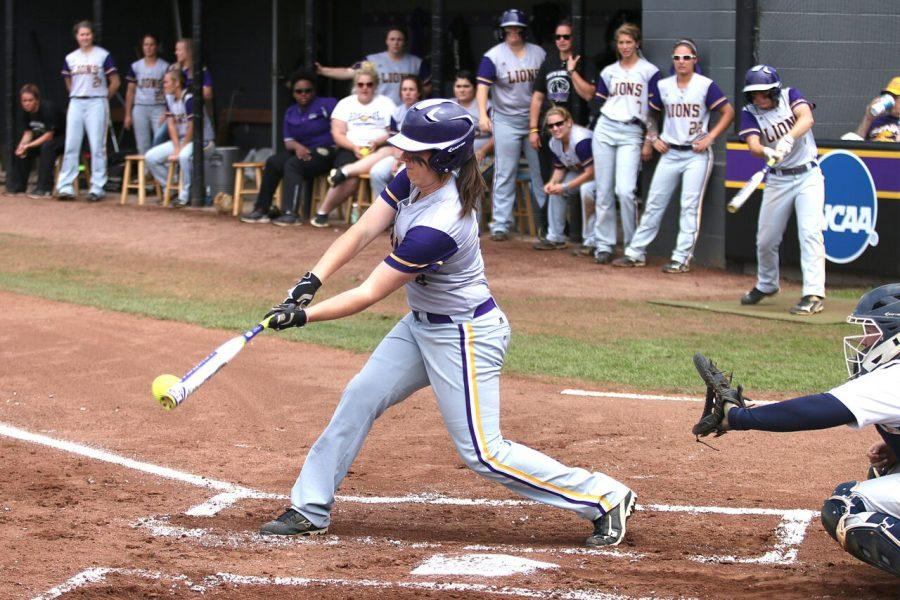 Senior first baseman Brooklynn Clark makes contact against Mississippi College April 10. Clark earned the 2016 Gulf South Conference Player of the Year award, head coach Ashley Cozart received Coach of the Year and six Lions made the All-GSC first team.