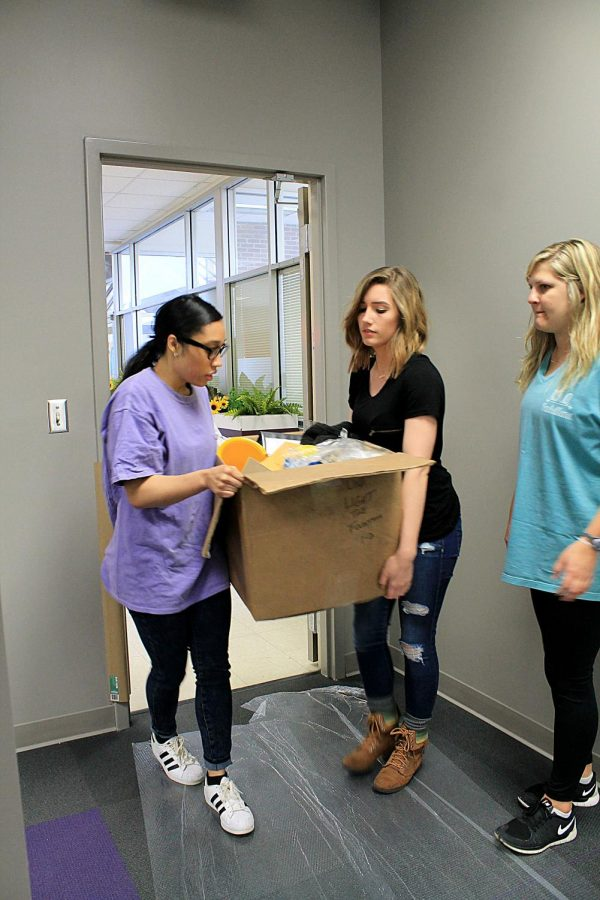 Treasurer of the Student Government Association Mallory Hayes, Student Leadership Consultant Kayla Land and intern Hailey Holke carry SGA materials into the new Student Engagement Center. The official move-in began April 8.