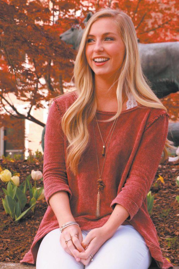 """Senior Baylee Pirtle created a project to collect food and clothes for children at Weeden Elementary. """"As a child, you shouldn't have to worry about when you're going to eat dinner,"""" she said."""