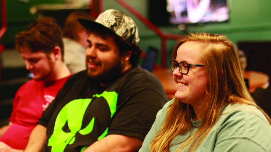UNA Video Game Association members (from left to right) Blake Dahlke, Codie Griffin and Katie Kelsoe battle one another in a game in the Lion's Den.  Female gamers account for 48 percent of people who play video games, according to a Pew Research Center survey.