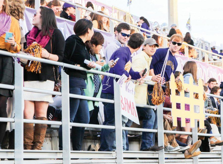The UNA student section cheers on the Lions during a homecoming game against Western Oregon Oct. 4, 2014. UNA Athletics and Student Government Association agreed to move the student section to the home side in 2016.