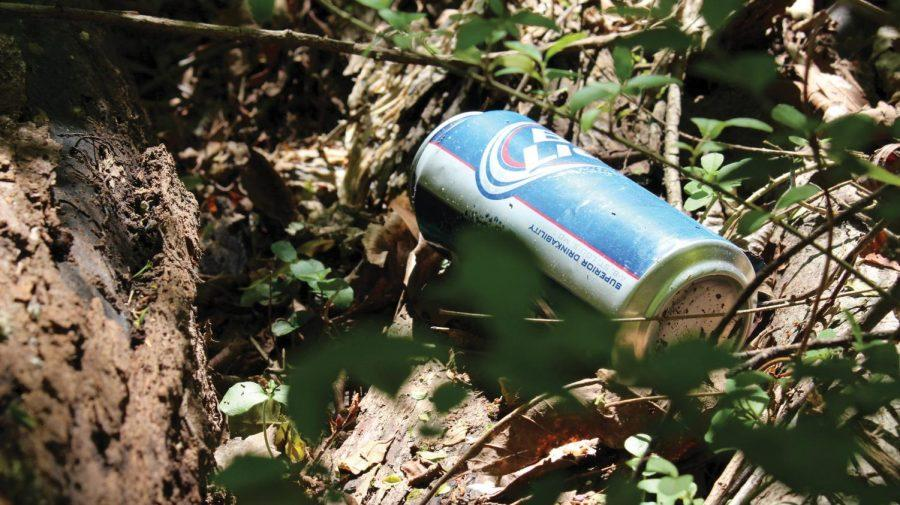 An+empty+beer+can+litters+the+ground+at+Wildwood+Park.+%E2%80%9CWildwood+is+an+underdeveloped+resource+that+many+don%E2%80%99t+know+about%2C%E2%80%9D+said+Outdoor+Adventure+Center+Coordinator+Patrick+Shremshock.+%E2%80%9CIf+we+don%E2%80%99t+take+care+of+it%2C+it+will+be+pushed+to+the+side%2C+and+that%E2%80%99s+not+what+we+want.%E2%80%9D