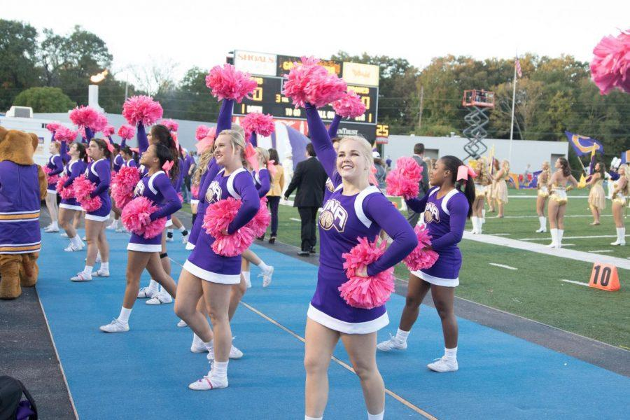 The UNA cheerleading team gets the crowd pumped up during the Lions' homecoming game against North Carolina-Pembroke October 17, 2015. The cheer squad earned a fourth place finish in a national event April 8.
