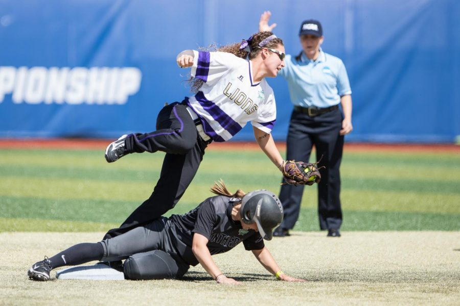UNA's sophomore shortstop Reagan Tittle attempts to turn a double play against Adelphi May 18 in the Division II Softball Championship in Denver. The Lions lost Game One of a three-game championship series vs. Humboldt State, falling 5-0.