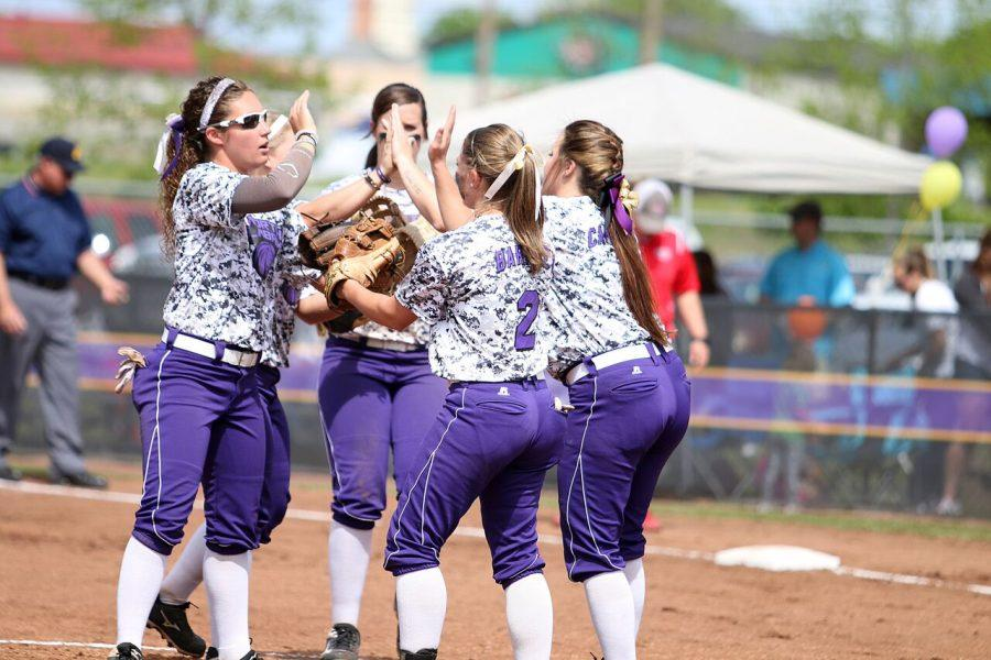 The+UNA+infielders%2C+along+with+junior+pitcher+Hillary+Carpenter+%28right%29%2C+celebrate+after+recording+an+out+against+Union+April+16.+The+Lions+won+the+Gulf+South+Conference+Championship+May+1+after+defeating+Valdosta+State+19-9.