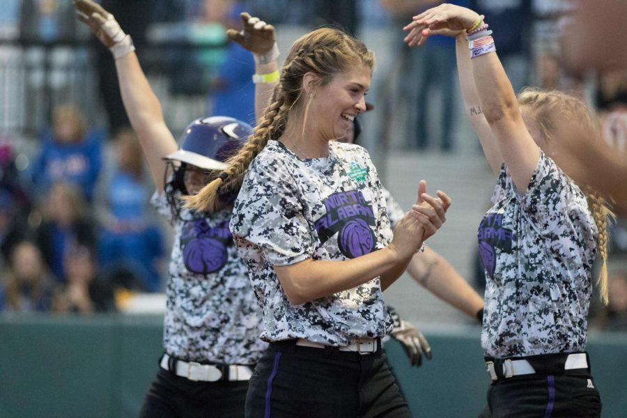 Senior+outfielder+Courtney+Shields+celebrates+with+teammates+during+the+Division+II+Softball+Championship+tournament+in+Denver.+Shields+went+5-for-7+in+the+final+two+games+of+the+championship+series+and+helped+the+Lions+hoist+its+first+national+championship+trophy+in+the+softball+program%27s+history.