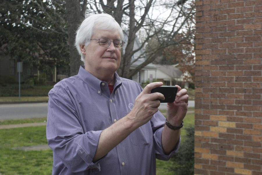 Bill Norvell prepares to snap a photo for social media. Norvell attends many UNA events and frequently interacts with the community.