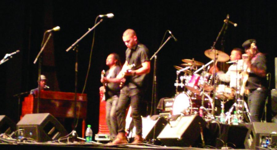 A+band+jams+out+at+the+2015+W.C.+Handy+Music+Festival.+The+event+offers+a+variety+of+music+for+listeners.