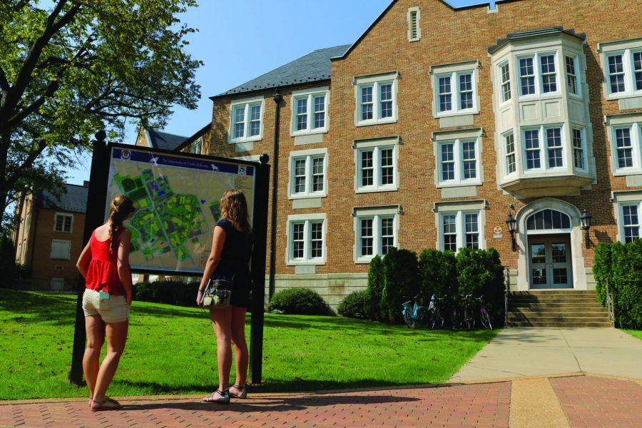 UNA students Savannah Herbst and Lynn Hartman use a campus map next to Keller Hall. Southern Living magazine gave UNA and Florence the nod as one of the South's best college towns last week.
