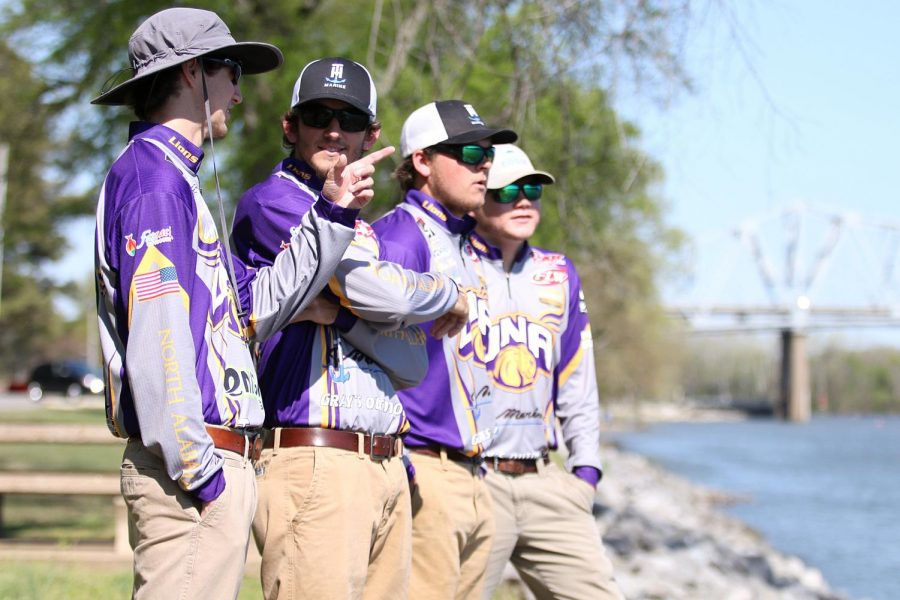 UNA+bass+fishermen+%28from+left+to+right%29+Andrew+Tate%2C+Makenzie+Henson%2C+Sloan+Pennington+and+Caleb+Dennis+come+up+with+a+fishing+strategy+at+McFarland+Park+April+4.+UNA+finished+second+in+the+Cabela%27s+School+of+the+Year+standings+this+season.