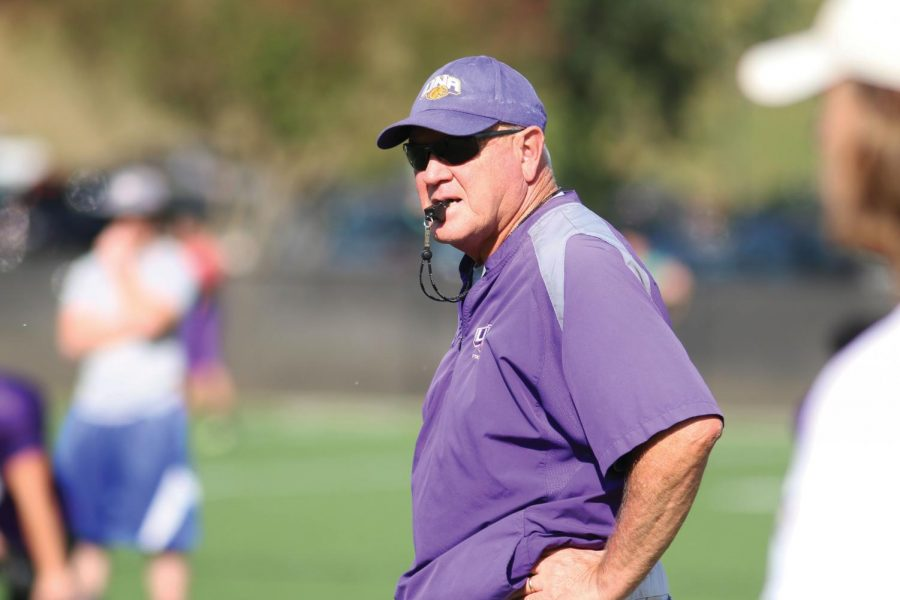 UNA head football coach Bobby Wallace looks on during a practice last season at the UNA practice field. With 17 starters and 43 lettermen returning, the Lions hope to win its fourth consecutive conference championship in 2016.