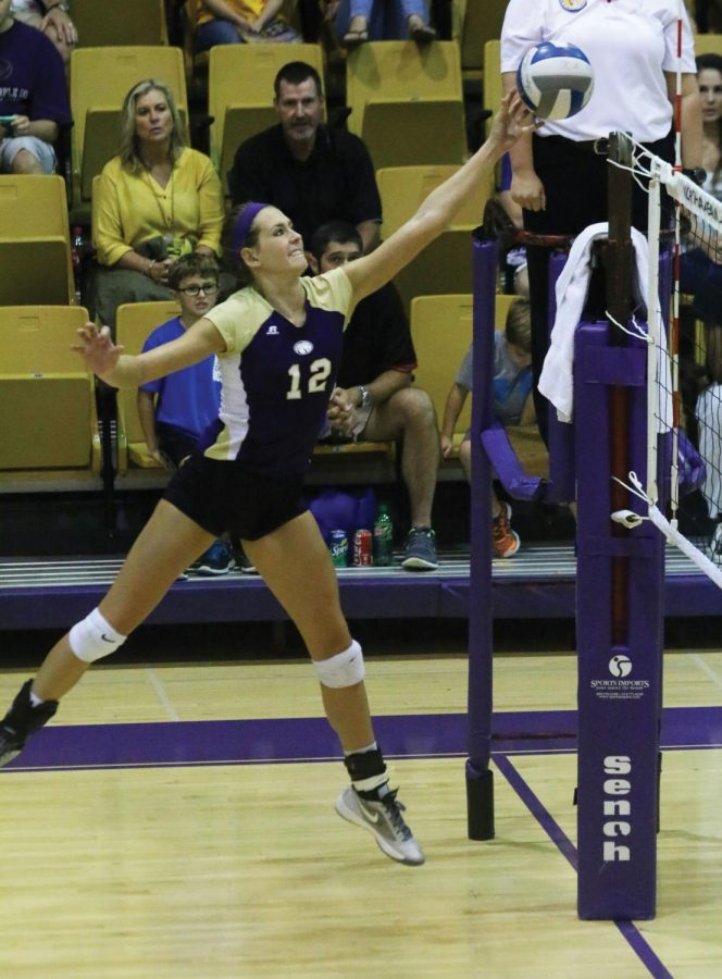 Junior+outside+hitter+Lexie+Bradley+tips+a+ball+over+the+net+during+a+volleyball+game+at+Flowers+Hall+during+the+2015+season.+The+GSC+coaches+picked+the+Lions+to+finish+second+after+winning+their+conference+a+season+ago.