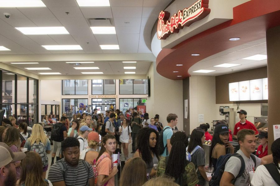 Students+wait+in+line+at+Chick-fil-A+in+the+Commons.+To+clear+up+the+lines%2C+UNA+plans+to+install+kiosks+which+students+can+use+to+order+their+food.