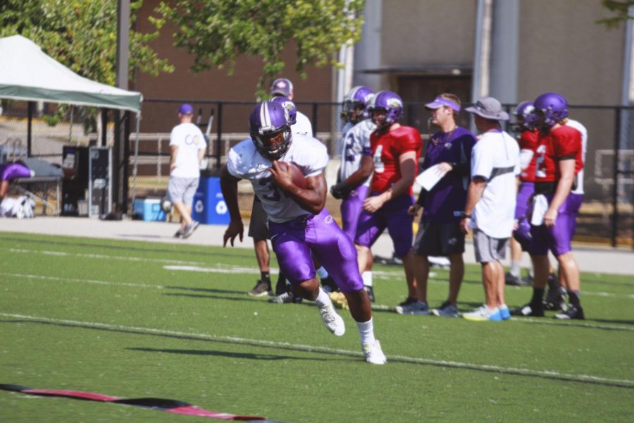 Freshman+running+back+Malik+Emmett+makes+a+cut+during+a+UNA+football+practice+Sept.+6.+The+UNA+football+team+has+a+multiplicity+of+running+backs+it+hopes+to+utilize+this+season.